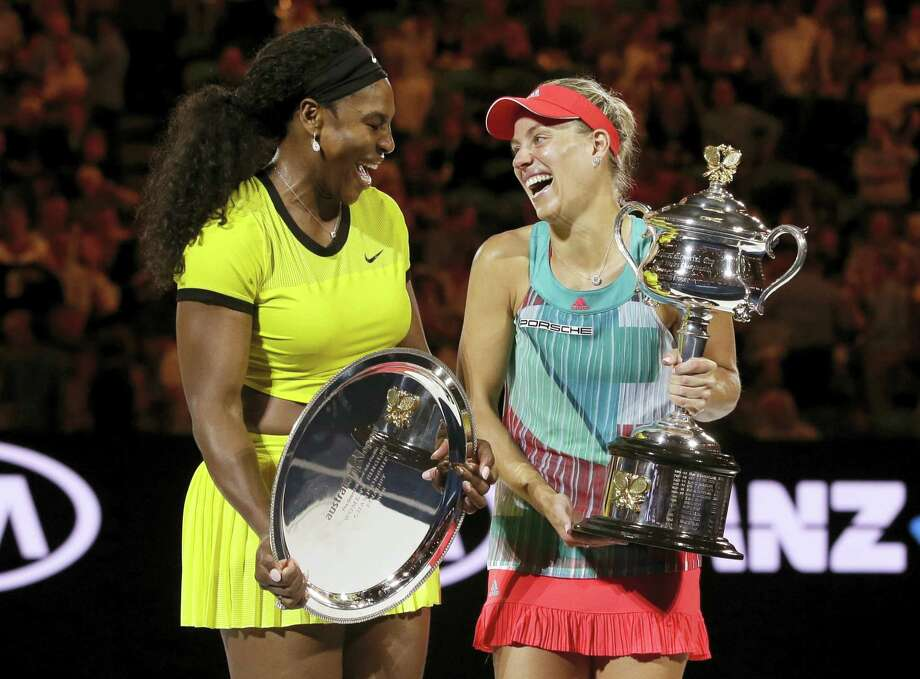 Angelique Kerber, right, of Germany enjoys a joke with runner-up Serena Williams of the United States after winning their women's singles final at the Australian Open tennis championships in Melbourne, Australia, Saturday, Jan. 30, 2016. Photo: AP Photo/Aaron Favila   / AP