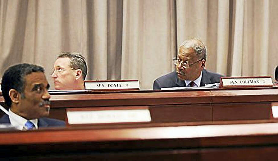 State Sens. Eric Coleman and Paul Doyle, and Rep. Bruce Morris listen to the debate in the Judiciary Committee. Photo: Christine Stuart Photo