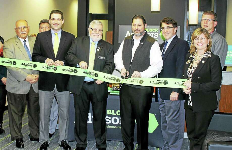 Block Advisors held its grand opening Jan. 14 at 51 Shunpike Road in Cromwell. From left are: Town Manager Anthony J. Salvatore, Vice President of the Middlesex County Chamber of Commerce Jeff Pugliese, Leon Zahaba Jr. of Block Advisors, Mayor Enzo Faienza, Director of Planning & Development Stuart B. Popper, Tracy Gardner of H&R Block, and co-chair of the Downtown Merchants Association Rodney Bitgood. Photo: Courtesy Photo