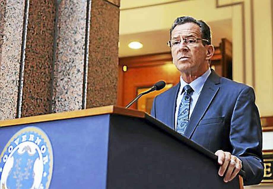 Gov. Dannel P. Malloy talks to the press following the Bond Commission meeting Friday. Photo: Christine Stuart Photo