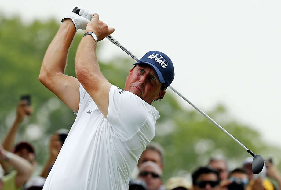 Phil Mickelson watches his tee shot on the 18th hole during the third round of the PGA Championship at Baltusrol Golf Club Saturday. Photo: Mike Groll — The Associated Press  / AP