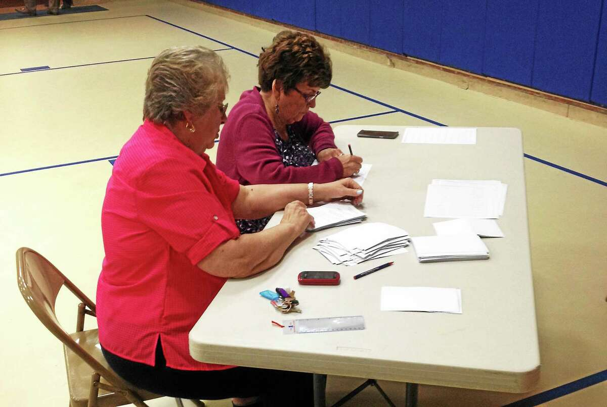 The Cromwell Fire District Board of Commissioners vote will be held Monday evening in the Town Hall gymnasium. Here, volunteers work the polls at last year's election.
