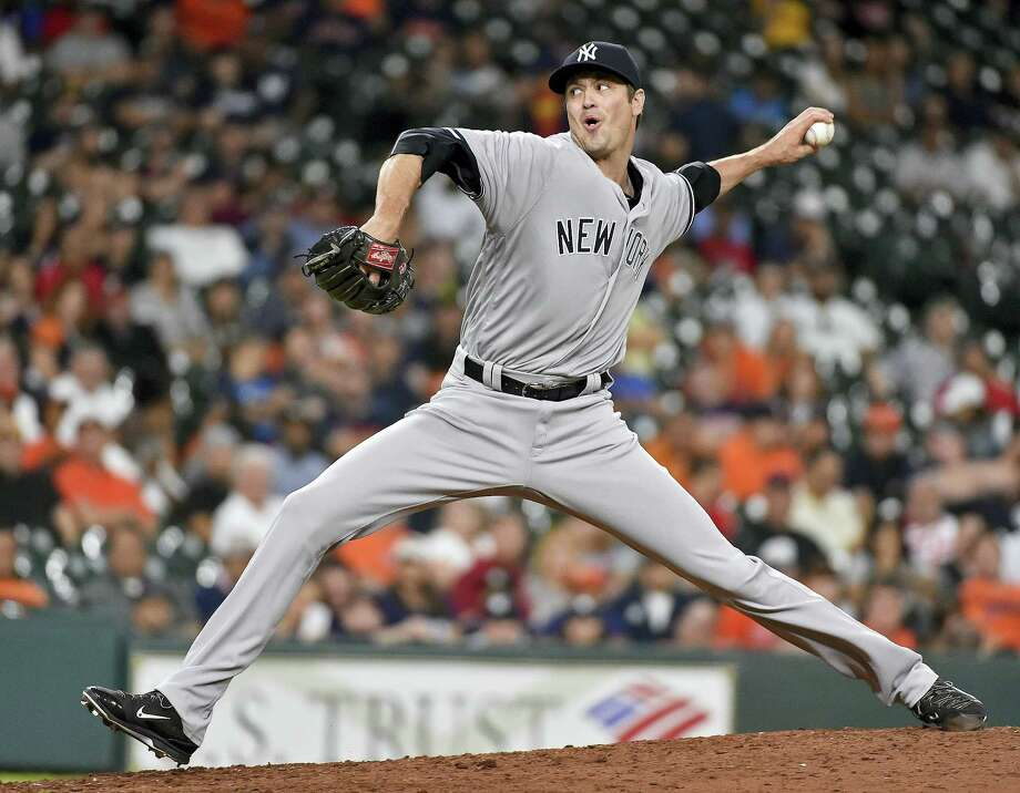 New York Yankees relief pitcher Andrew Miller can help the Yankees make a run at a wild card berth. But Register columnist thinks he's better suited as trade bait to build for the future. Photo: AP File Photo  / FR171023 AP