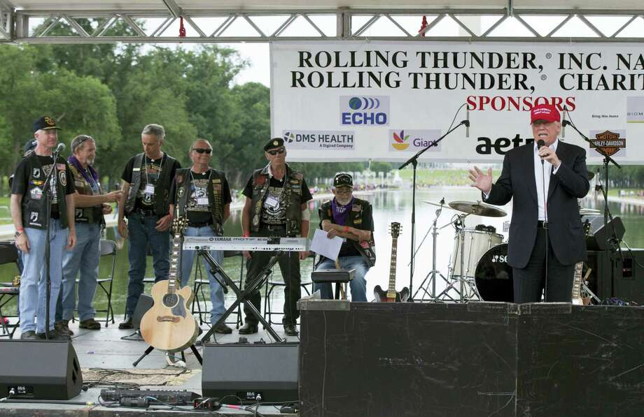 Republican presidential candidate Donald Trump, right, speaks to supporters and bikers at a Rolling Thunder rally at the National Mall in Washington on Sunday. Photo: ASSOCIATED PRESS  / Copyright 2016 The Associated Press. All rights reserved. This material may not be published, broadcast, rewritten or redistribu