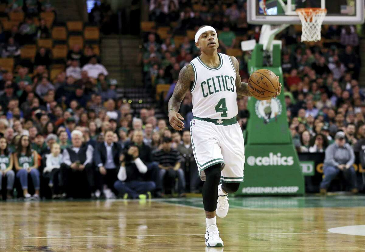 Celtics guard Isaiah Thomas dribbles up court against the Magic on Friday.