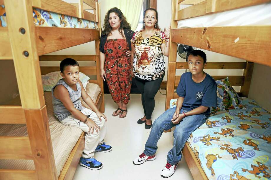 Life Haven case worker Samantha Miranda, center left, with Awilda Gonzalez and her two boys, Xsavier Morales, 7, left, and Isaiah Gonzalez, 11, at the shelter in New Haven on Thursday. Photo: Arnold Gold — New Haven Register