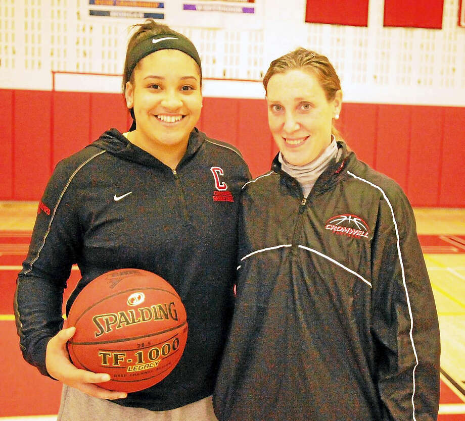 Cromwell's Mya Villard, pictured with Panthers head coach Kelly Maher, became the ninth player in Cromwell girls basketball history to score 1,000 points this week. Photo: Jimmy Zanor — The Middletown Press