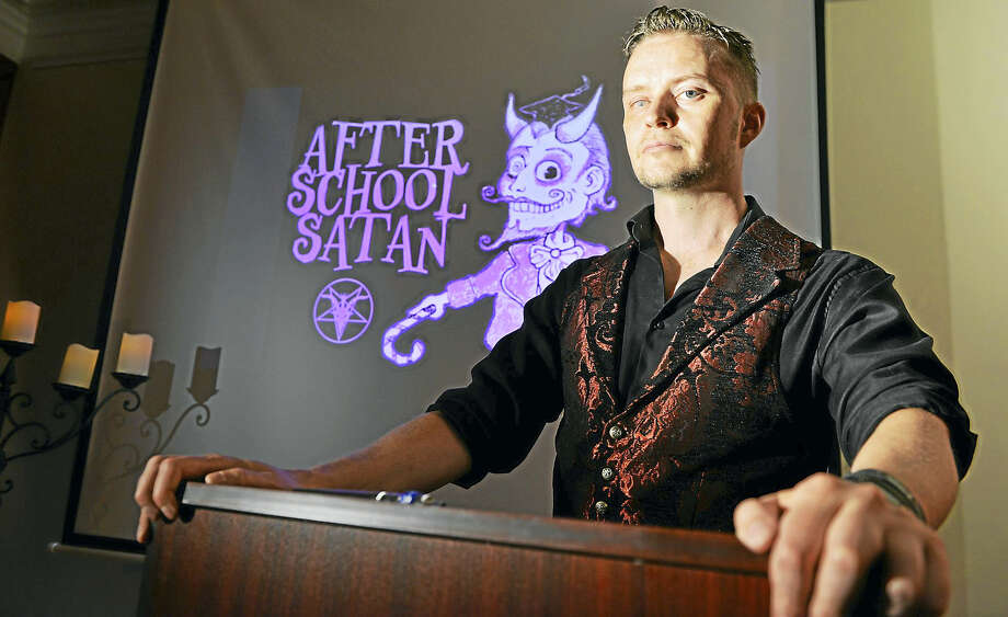 Doug Mesner, a.k.a. Lucien Greaves, with the logo for the Satanic Temple's proposed After School Satan Club. Photo by Josh Reynolds for The Washington Post. Photo: For The Washington Post / For The Washington Post