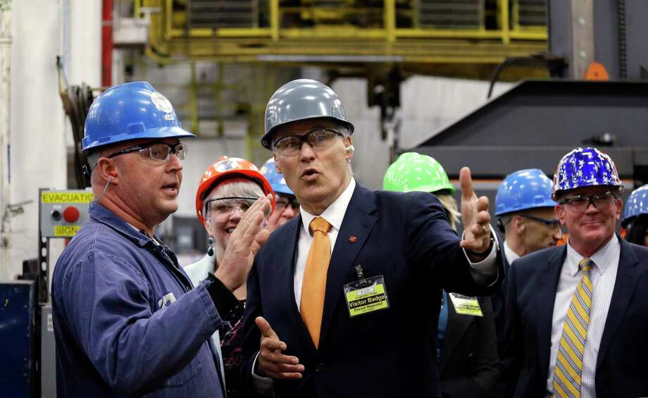 Jorgensen Forge master machinist Jeff Cuvelier, left, talks with Gov. Jay Inslee on a tour of the plant Tuesday, Jan. 26, 2016, in Seattle. Inslee unveiled the Washington Defense Data Tool, which his office said will help in efforts to protect and grow businesses supported by Washingtonís defense industry. The tool is a result of a $500,000 grant from the Department of Defense Office of Economic Adjustment to develop an economic assessment database. Photo: AP Photo/Elaine Thompson   / AP