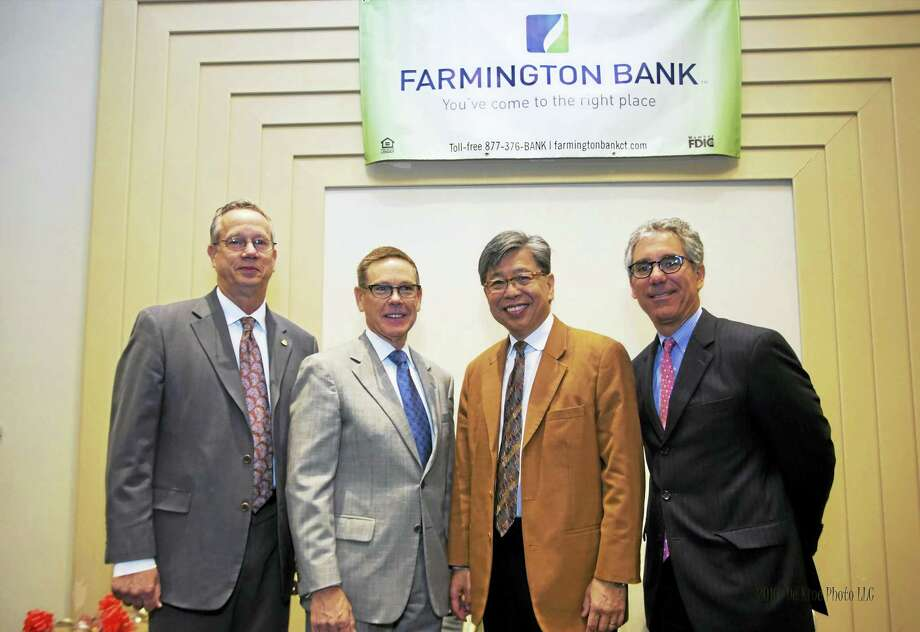 President and CEO of Jackson Laboratory Edison T. Liu spoke to members of the Middlesex County Chamber of Commerce at the May member breakfast. From left are vice chairman of the Middlesex County Chamber of Commerce Gregory Shook, chairman, president and CEO of Farmington Bank John J. Patrick Jr., Liu, and chairman of the Middlesex County Chamber of Commerce Vincent Capece. Photo: Photo Courtesy Of De Kine Photo, LLC  / (c)DE KINE PHOTO LLC
