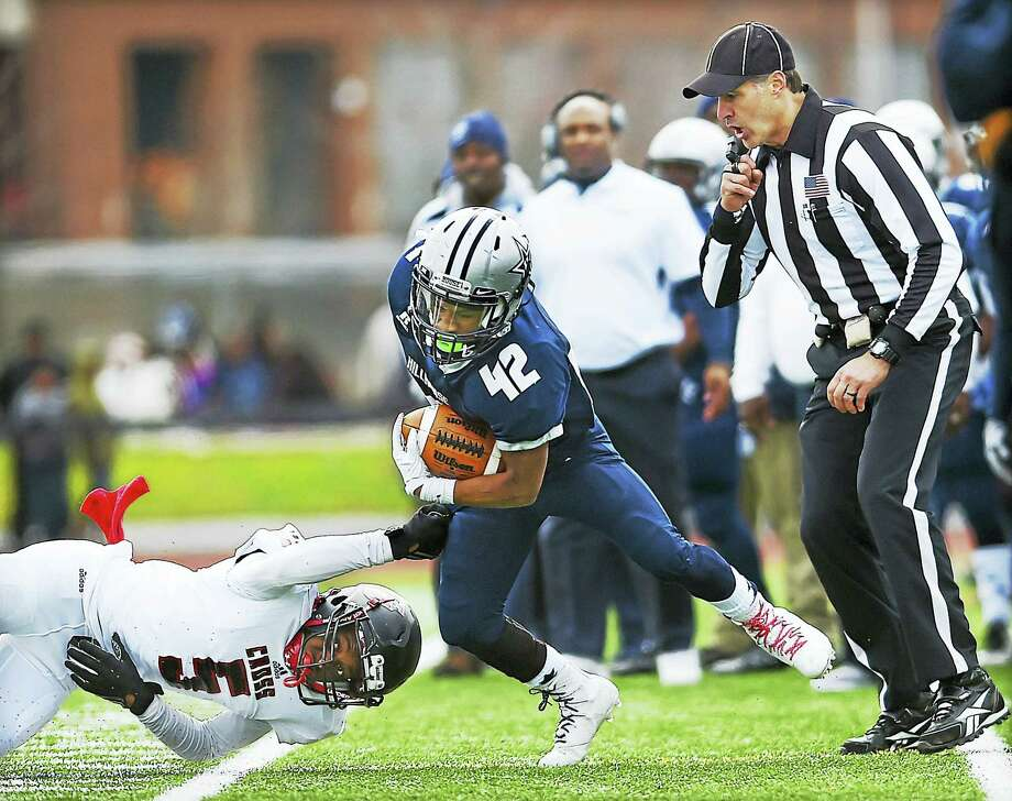 Hillhouse senior running back David Harris runs out of bounds in an attempt to avoid a tackle Cross freshman Donnie Gray Jr. in a 33-20 win for the Academics in the Elm City Bowl,  Thanksgiving morning, November 24, 2016, at Bowen Field in New Haven. Photo: Catherine Avalone — New Haven Register / New Haven RegisterThe Middletown Press
