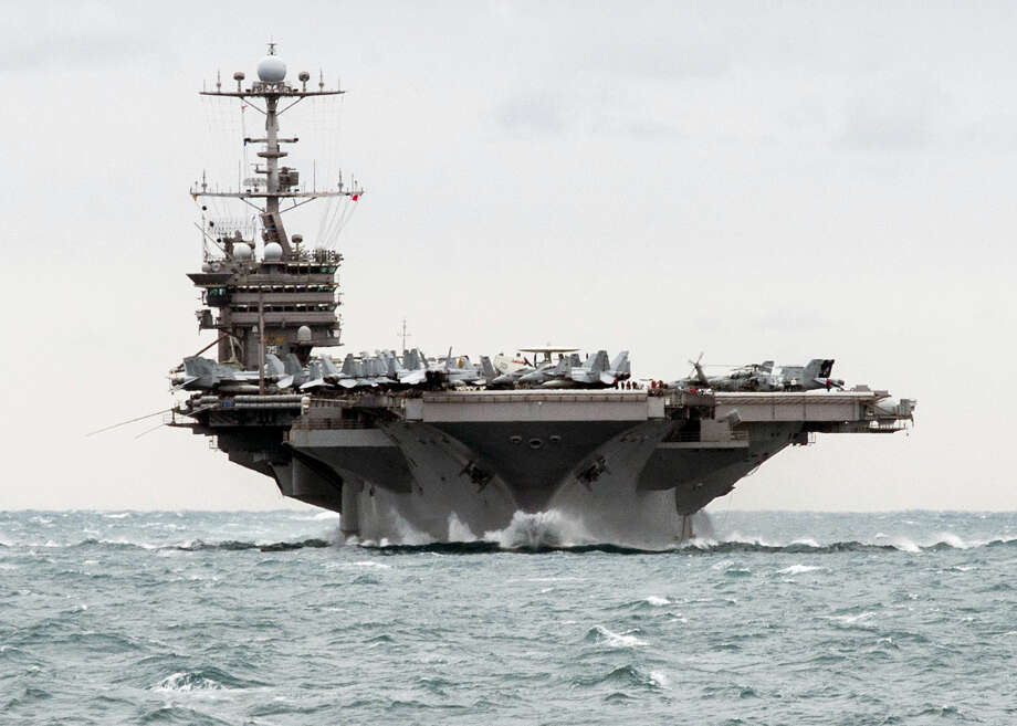 "In this Saturday, Dec. 26, 2015 photo released by the U.S. Navy, the aircraft carrier USS Harry S. Truman transits the Strait of Hormuz. Iran flew a surveillance drone over a U.S. aircraft carrier and took ""precise"" photographs of it as part of an ongoing naval drill, state television reported Friday. The U.S. Navy said an unarmed Iranian drone flew near a French and American carrier on Jan. 12, but couldn't confirm it was the same incident. Photo: Mass Communication Spc. 2nd Class M. J. Lieberknecht/U.S. Navy Via AP, File   / U.S. Navy"