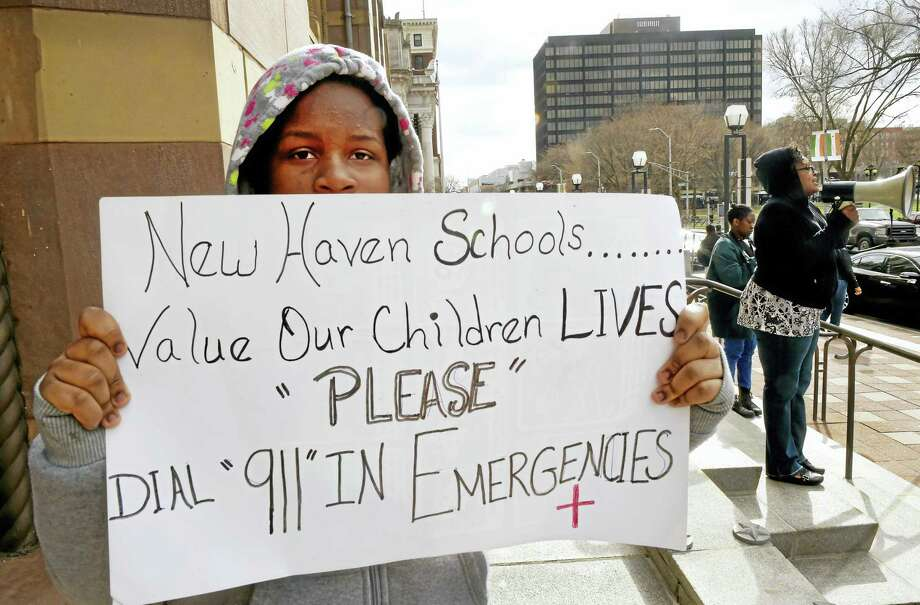 With her daughter Janya Adonai, 14, of Meriden, left, Gwen Samuel of Meriden, right, interim director of the New Haven based advocacy group Teach Our Children, shouts into a bullhorn on the steps of New Haven City Hall March 18. Photo: Peter Hvizdak — New Haven Register FILE PHOTO  / ?2016 Peter Hvizdak