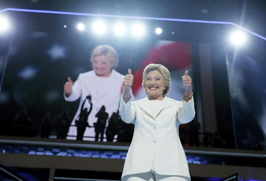 Democratic presidential nominee Hillary Clinton gives a thumbs-up as she appears on stage during the final day of the Democratic National Convention in Philadelphia Thursday. Photo: Carolyn Kaster — The Associated Press  / Copyright 2016 The Associated Press. All rights reserved. This material may not be published, broadcast, rewritten or redistribu