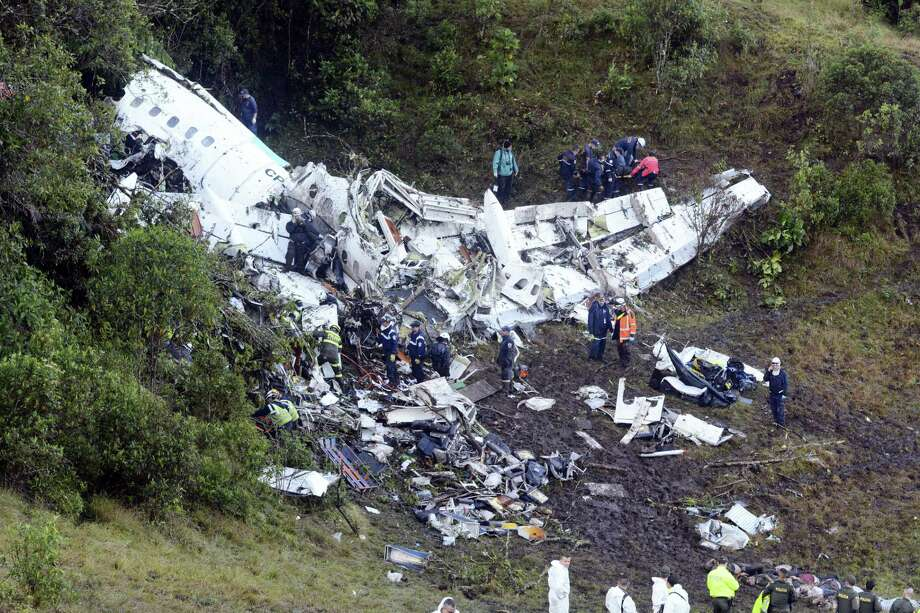 Rescue workers carry a body away from he wreckage of a chartered airplane that crashed in La Union, a mountainous area outside Medellin, Colombia, Tuesday , Nov. 29, 2016. The plane was carrying the Brazilian first division soccer club Chapecoense team that was on it's way for a Copa Sudamericana final match against Colombia's Atletico Nacional. Photo: AP Photo/Luis Benavides   / Copyright 2016 The Associated Press. All rights reserved.