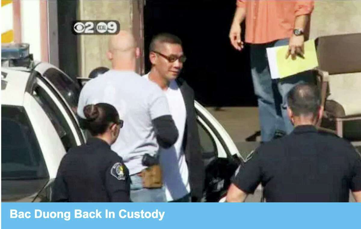 This frame from video provided by KCBS-TV/KCAL-TV shows Bac Duong, one of three inmates who escaped from the Orange County jail, being returned to the Santa Ana, Calif., jail after he turned himself in Friday, Jan. 29, 2016. The two other inmates who escaped with him remained at large Friday afternoon.