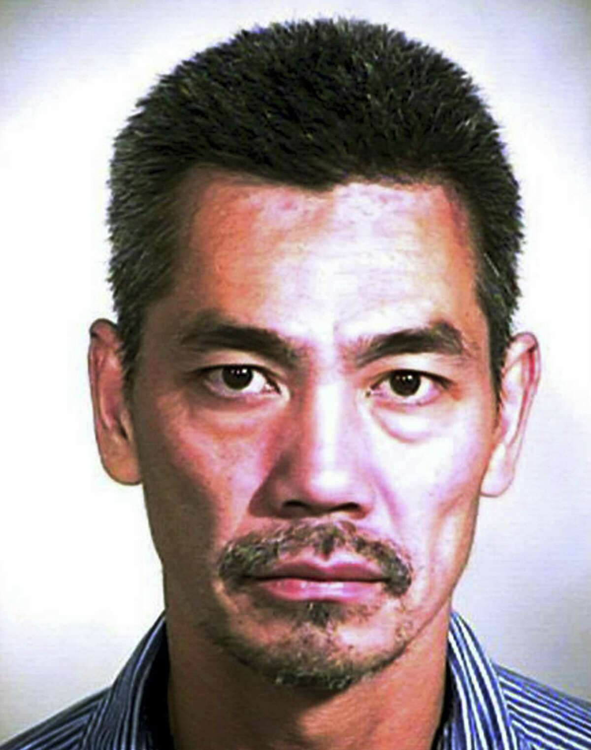 FILE - This undated photo provided by the Orange County Sheriff's Office shows Bac Duong, one of three inmates who escaped Friday, Jan. 22, 2016, from the county's Central Men's Jail in Santa Ana, Calif. Duong has been captured, leaving 2 still at large.