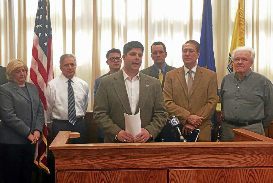 During a press conference Wednesday, Mayor Daniel Drew announced that Standard & Poor's Rating Services awarded Middletown an AAA bond rating, the highest possible designation a city can receive. From left are Council Minority Leader Sebastian Giuliano, Councilman Robert Blanchard, Drew, the city's financial adviser Matt Spoerndle and Council Majority Leader Thomas Serra. Photo: Sam Norton — The Middletown Press