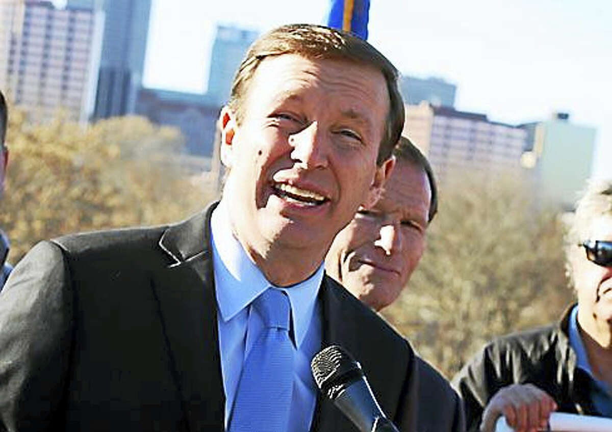 U.S. Sen. Chris Murphy on Monday speaks at a press conference in East Hartford.