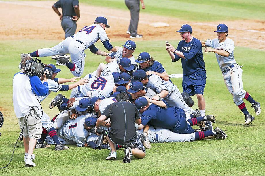 Members of the UConn baseball team celebrate after winning the AAC championship on Sunday. Photo: Photo Courtesy Of UConn Athletics  / Stephen Slade