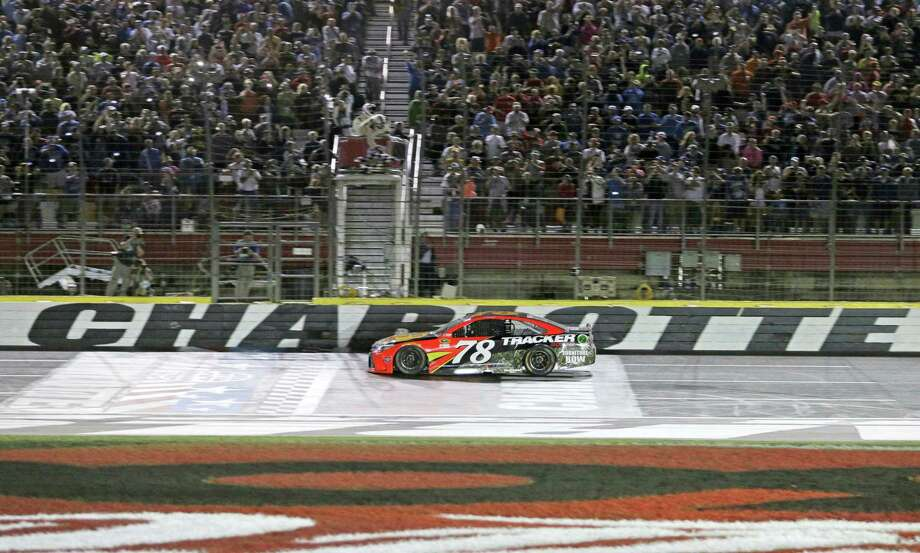 Martin Truex Jr takes the checkered flag to win Coca-Cola 600 at Charlotte Motor Speedway on Sunday. Photo: Chuck Burton — The Associated Press  / Copyright 2016 The Associated Press. All rights reserved. This material may not be published, broadcast, rewritten or redistribu