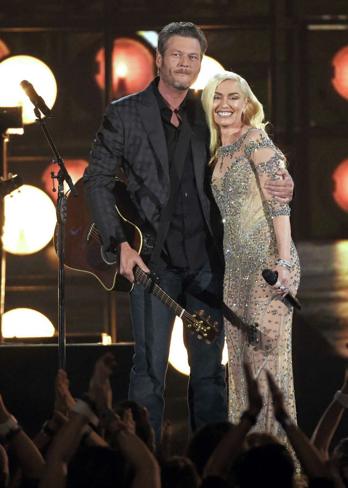 "In this May 22, 2016, file photo, Blake Shelton, left, and Gwen Stefani perform ""Go Ahead and Break My Heart"" at the Billboard Music Awards at the T-Mobile Arena in Las Vegas. Actress Debra Messing apologized to both Shelton and Stefani on July 28, 2016, after calling on Stefani to encourage Shelton not to vote for Donald Trump."