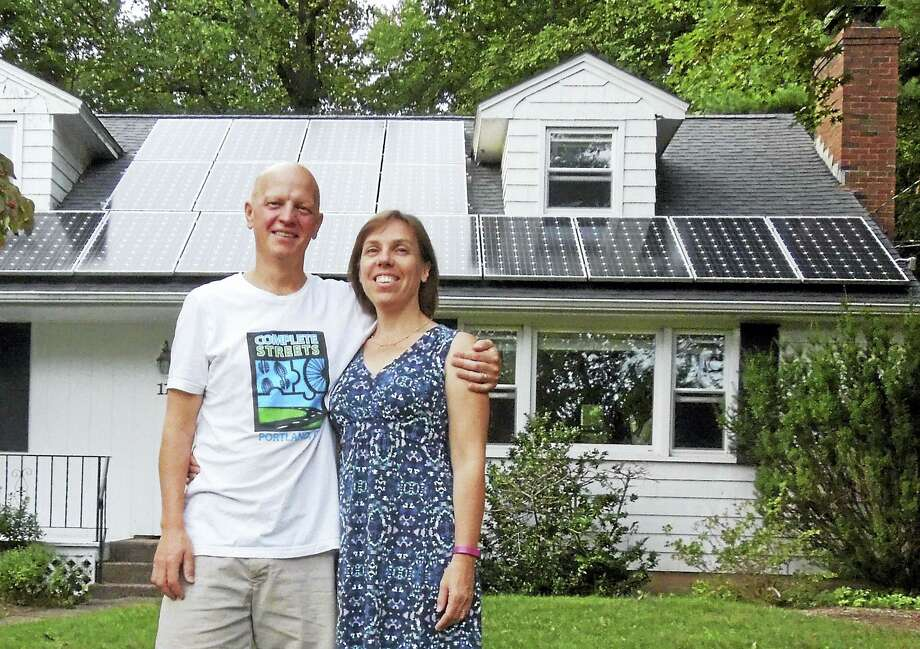 Chris and Kerry Darby of Portland, who installed an 8kW solar array in 2012 as part of Portland's first Solarize CT program, are saving $100 a month on their electricity bill. The most they have paid a year for electricity is $80 above the monthly $19.25 service charge. Photo: Contributed Photo