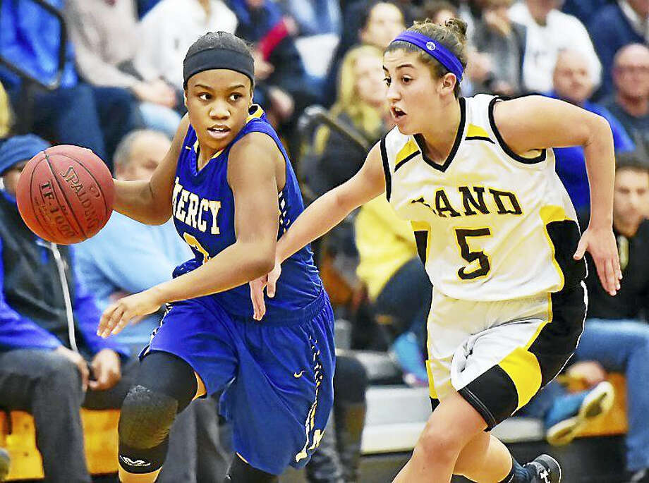 Mercy captain Destine Perry drives to the hoop as Hand's Gillian Draemer defends in a 77-56 win for the Mercy Tigers, Wednesday, January 27, 2016, at Daniel Hand High School in Madison. Photo: Catherine Avalone – New Haven Register  / New Haven RegisterThe Middletown Press
