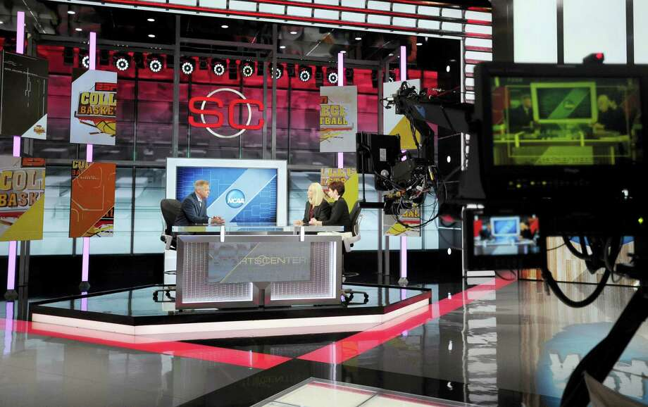 In this Nov. 3, 2015 photo, Notre Dame head coach Muffet McGraw, right, sits with Maryland head coach Brenda Frese for a live interview with sportscaster David Lloyd, left, on SportsCenter at ESPN in Bristol, Conn. Photo: AP Photo/Jessica Hill, File  / FR125654 AP