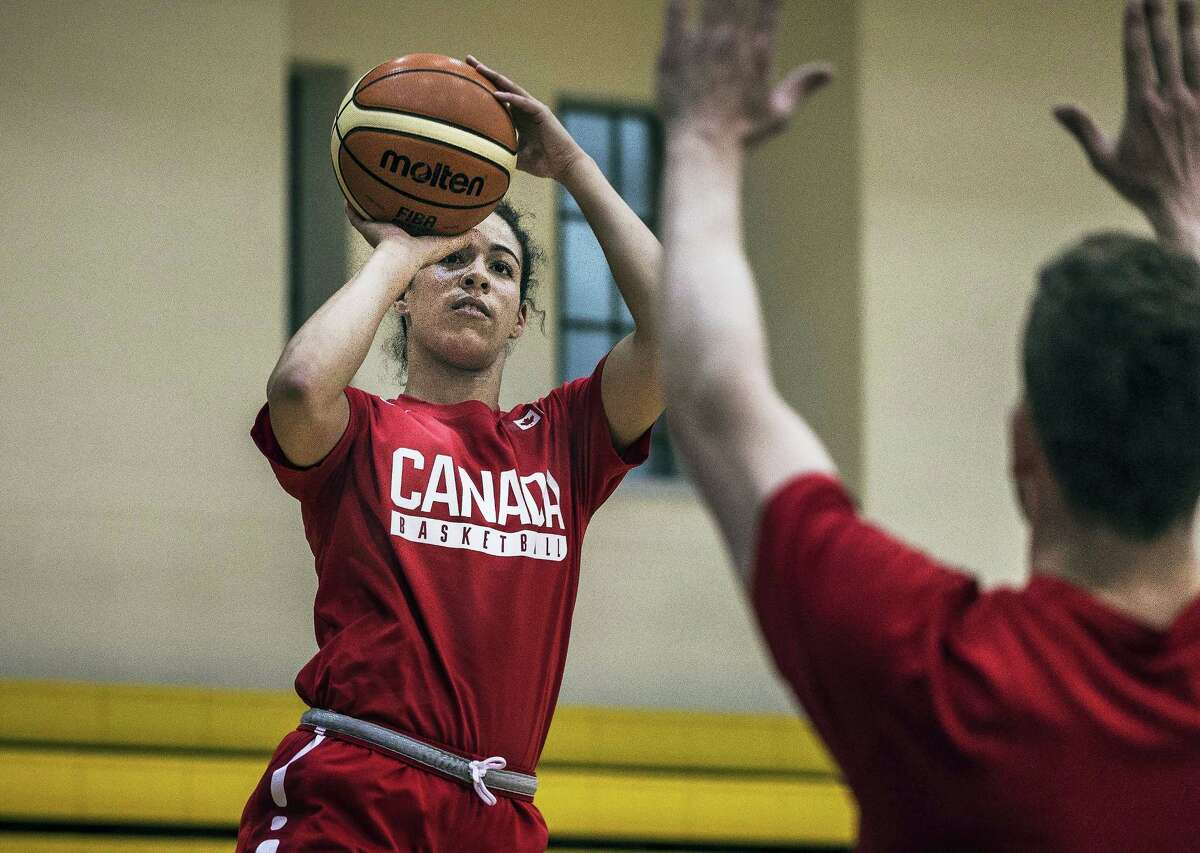Point guard Kia Nurse takes a shot during practice after a press conference introducing Canada's women's basketball Olympic team in Toronto, Friday, July 22, 2016. (Aaron Vincent Elkaim/The Canadian Press via AP)