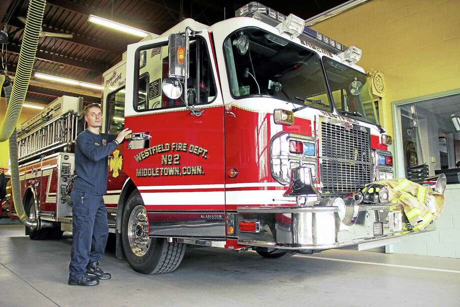 Firefighter Scott Kotowski started out as a junior recruit in Milford, progressing to volunteer firefighter with Middletown's Westfield Fire, where he was eventually hired. Kotowski continues work as a volunteer, he said. Photo: Kathleen Schassler — The Middletown Press  / Kathleen Schassler All Rights