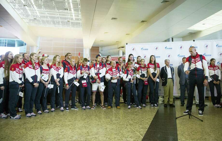 Volleyball player and Russia's National Olympic team member Sergey Tetyukhin, front right, speaks during the farewell ceremony before Russian team's departure to Rio Olympics, in Moscow, Russia on July 28, 2016. More than 100 Russians from the 387-strong Olympic team have been banned so far from going to Rio de Janeiro in connection with the country's doping scandal. Photo: AP Photo/Pavel Golovkin  / Copyright 2016 The Associated Press. All rights reserved. This material may not be published, broadcast, rewritten or redistribu