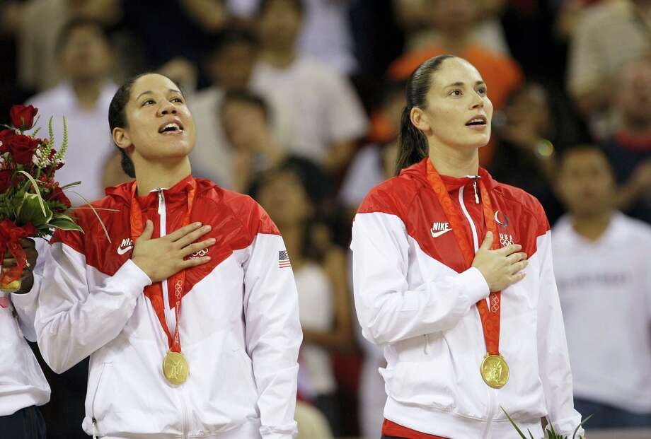 In this Aug. 23, 2008 photo, Kara Lawson left, and Sue Bird, both of the United States, sing their national anthem during the gold medal ceremony for women's basketball at the Beijing 2008 Olympics. Bird is aiming for her fourth gold medal in Rio. Photo: ASSOCIATED PRESS FILE PHOTO  / AP2008