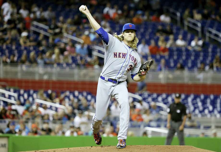 New York Mets starting pitcher Noah Syndergaard throws to first during the first inning of a baseball game against the Miami Marlins on Tuesday in Miami. Photo: Lynne Sladky-The Associated Press  / Copyright 2016 The Associated Press. All rights reserved.