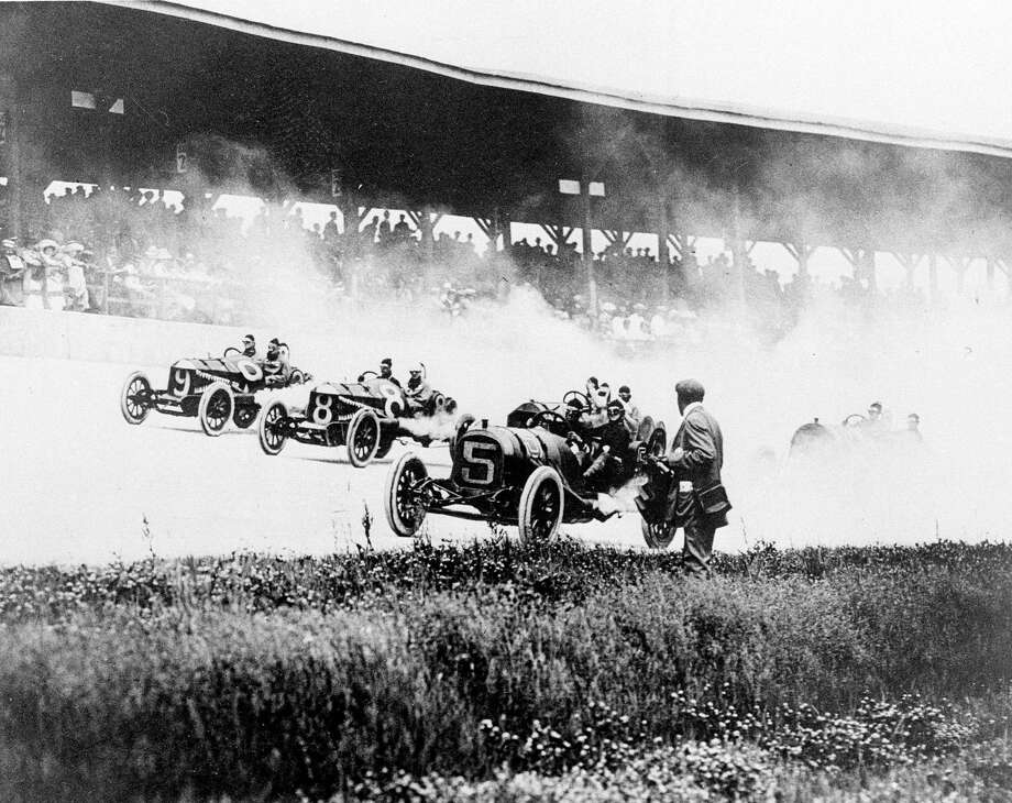 In this 1911 photo, drivers Will Jones (9), Joe Jagersberger (8) and Louis Disbrow (5) race in the first Indianapolis 500. Photo: The Associated Press File Photo  / Copyright 2016 The Associated Press. All rights reserved. This material may not be published, broadcast, rewritten or redistribu