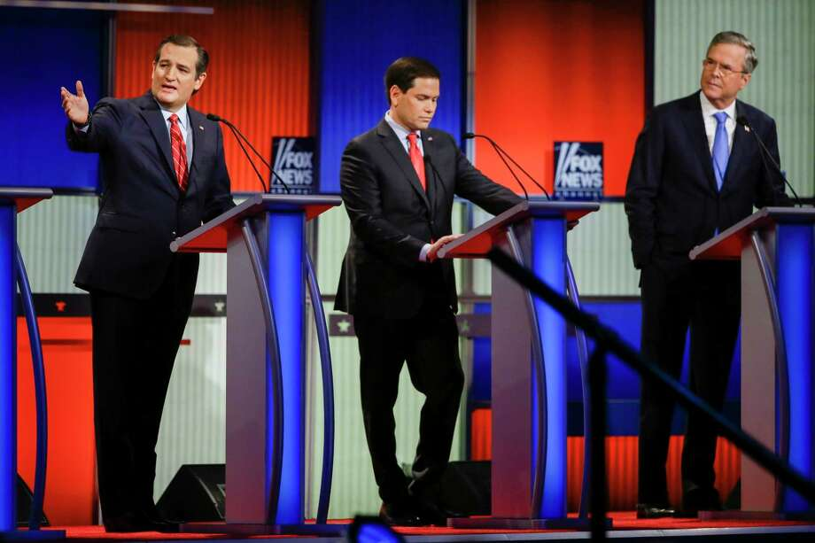 Republican presidential candidate Sen. Ted Cruz, R-Texas, left, answers a question as Sen. Marco Rubio, R-Fla., center, listens and former Florida Gov. Jeb Bush, right, looks on during a Republican presidential primary debate, Thursday, Jan. 28, 2016, in Des Moines, Iowa. Photo: AP Photo/Charlie Neibergall / AP