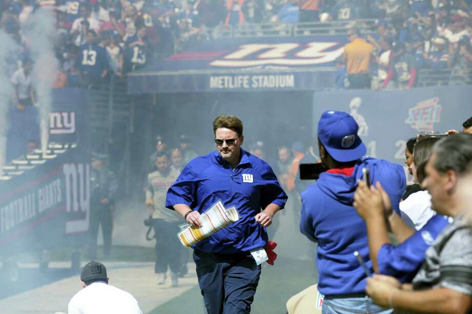 New York Giants head coach Ben McAdoo takes the field to start the first half of an NFL football game against the Washington Redskins Sunday, Sept. 25, 2016, in East Rutherford, N.J.  (AP Photo/Bill Kostroun) Photo: AP / FR51951 AP