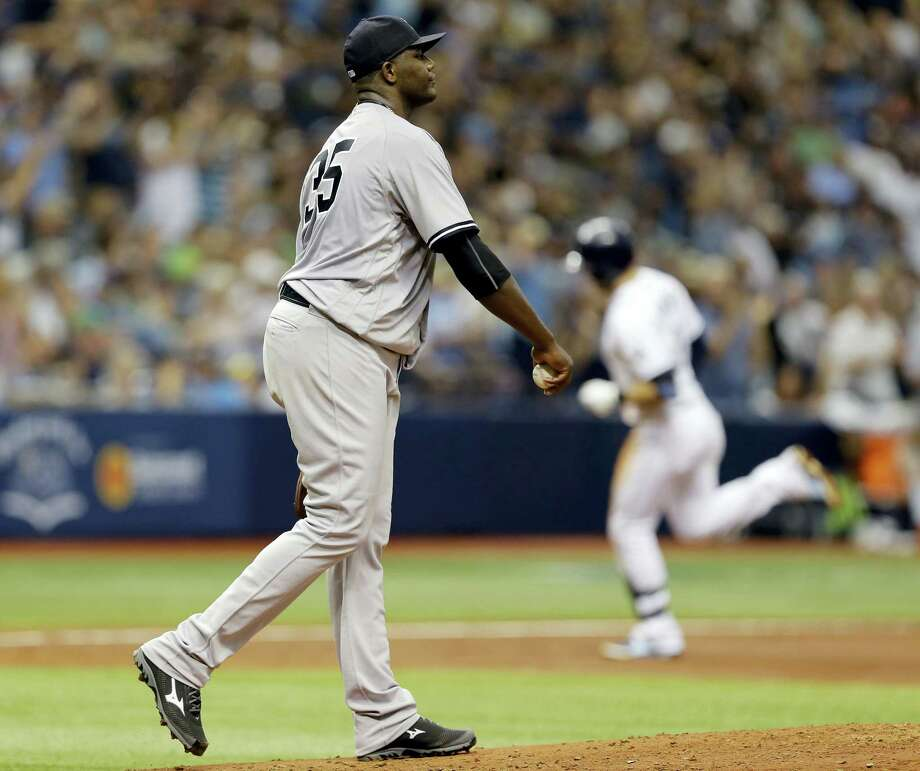 Yankees starting pitcher Michael Pineda walks back to the mound as Evan Longoria rounds the bases after hitting a two-run home run on Saturday. Photo: Chris O'Meara — The Associated Press  / Copyright 2016 The Associated Press. All rights reserved. This material may not be published, broadcast, rewritten or redistribu
