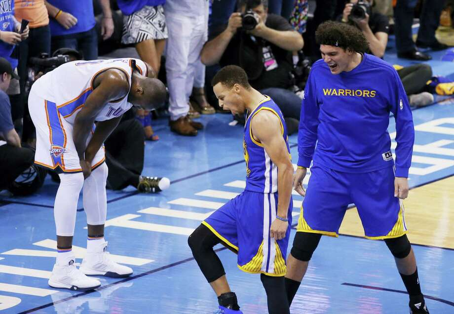 Stephen Curry, left, and Anderson Varejao (18) celebrate as Thunder forward Serge Ibaka reacts during the second half of Game 6 on Saturday. The Warriors won 108-101. Photo: Sue Ogrocki — The Associated Press  / AP