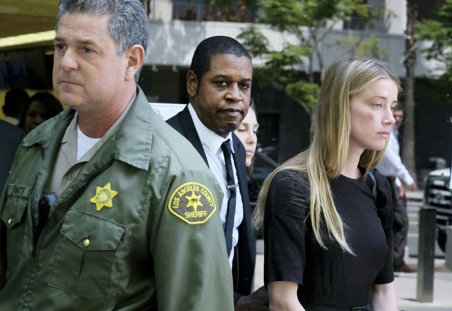 Actress Amber Heard leaves Los Angeles Superior Court court on Friday, May 27, 2016, after giving a sworn declaration that her husband Johnny Depp threw her cellphone at her during a fight, striking her cheek and eye. The judge ordered Depp to stay away from his estranged wife and ruled that Depp shouldn't try to contact Heard until a hearing is conducted on June 17. Heard filed for divorce on Monday. Photo: AP Photo/Richard Vogel   / Copyright 2016 The Associated Press. All rights reserved. This material may not be published, broadcast, rewritten or redistribu