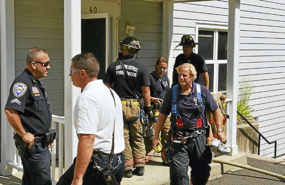 Middletown and South Fire District crews quickly extinguished a kitchen fire Thursday morning at Maplewood Terrace but resulting smoke damage prompted city officials to declare it uninhabitable. Photo: Cassandra Day — The Middletown Press