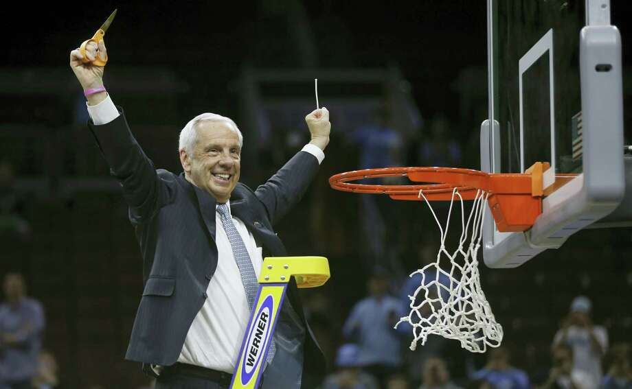 North Carolina head coach Roy Williams reacts after cutting the net after a regional final men's college basketball game against Notre Dame in the NCAA Tournament, Sunday, March 27, 2016, in Philadelphia. North Carolina won 88-74 to advance to the Final Four. (AP Photo/Matt Rourke) Photo: AP / Copyright 2016 The Associated Press. All rights reserved. This material may not be published, broadcast, rewritten or redistributed without permission.