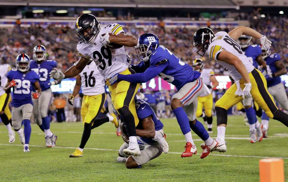 Pittsburgh running back Terrell Watson (39) barrels into the end zone with New York Giants cornerback Michael Hunter and linebacker Eric Pinkins (37) in tow. Photo: Julio Cortez, STF / Copyright 2017 The Associated Press. All rights reserved.