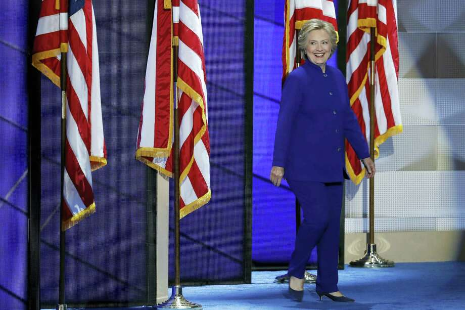 Democratic presidential nominee Hillary Clinton walks on stage after President Barack Obama's speech during the third day of the Democratic National Convention in Philadelphia on July 27, 2016. Photo: AP Photo/J. Scott Applewhite  / Copyright 2016 The Associated Press. All rights reserved. This material may not be published, broadcast, rewritten or redistribu