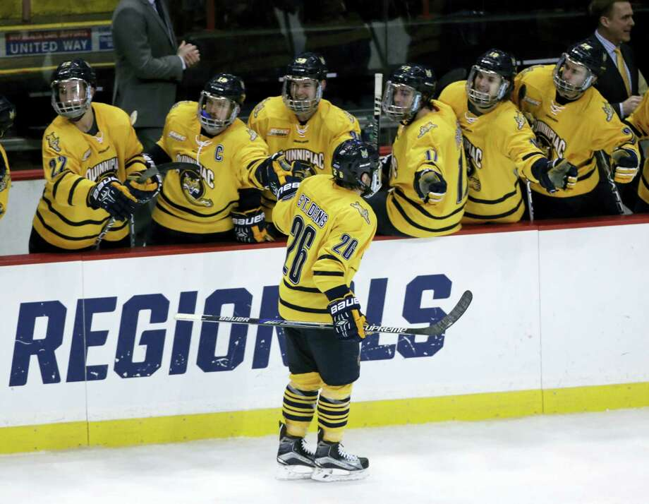 Quinnipiac's Travis St. Denis (26), celebrating his goal against UMass Lowell during the third period of the NCAA men's East Regional championship game on Sunday, is the only present Quinnipiac player who saw ice time in the 2013 Frozen Four. Photo: Mike Groll — The Associated Press  / Copyright 2016 The Associated Press. All rights reserved. This material may not be published, broadcast, rewritten or redistributed without permission.
