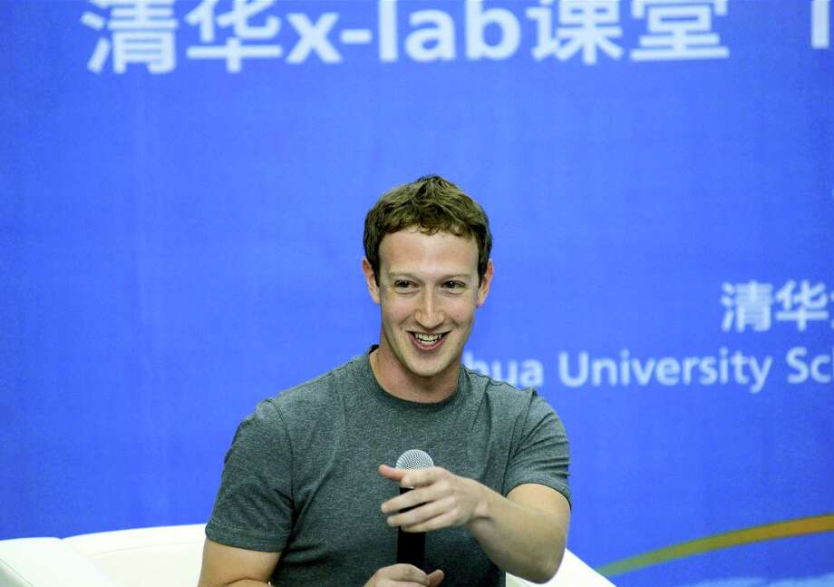 In this 2014 photo, Facebook co-founder Mark Zuckerberg speaks during a dialogue with students as a member to the advisory board for Tsinghua University School of Economics and Management in Beijing, China. Photo: AP Photo — Tsinghua University   / Tsinghua University