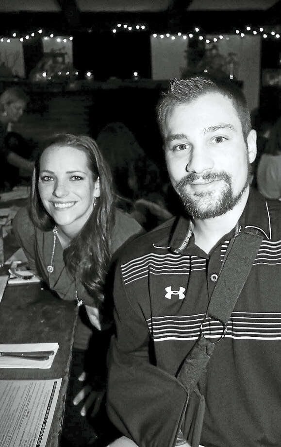 East Hampton Police Officer Hardie Burgin is shown with his wife Emily. Burgin was seriously hurt in early September when a car hit him while he was working street duty. He's recovering from multiple injuries but remains in pain and could suffer longtime damage. Photo: Contributed Photo