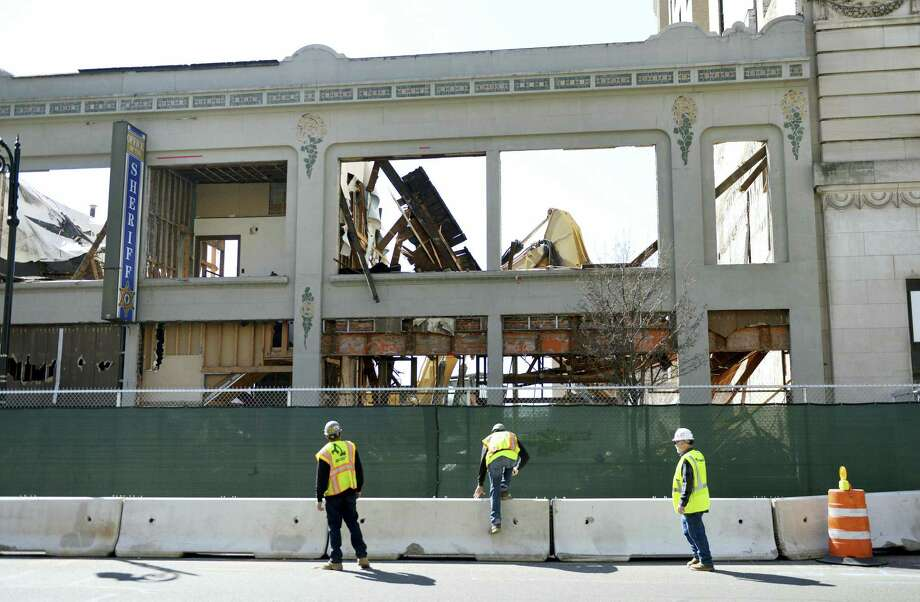 In this March 9, 2016 photo, a building at 1170 Main Street undergoes demolition to make way for the MGM casino project in Springfield, Mass. The project endured a lengthy review by historic preservation authorities over the planned demolition of downtown buildings in the months after the March 24, 2015 groundbreaking. The casino is now slated to open September 2018, a year behind initial projections. Photo: Don Treeger/The Republican Via AP  / The Republican
