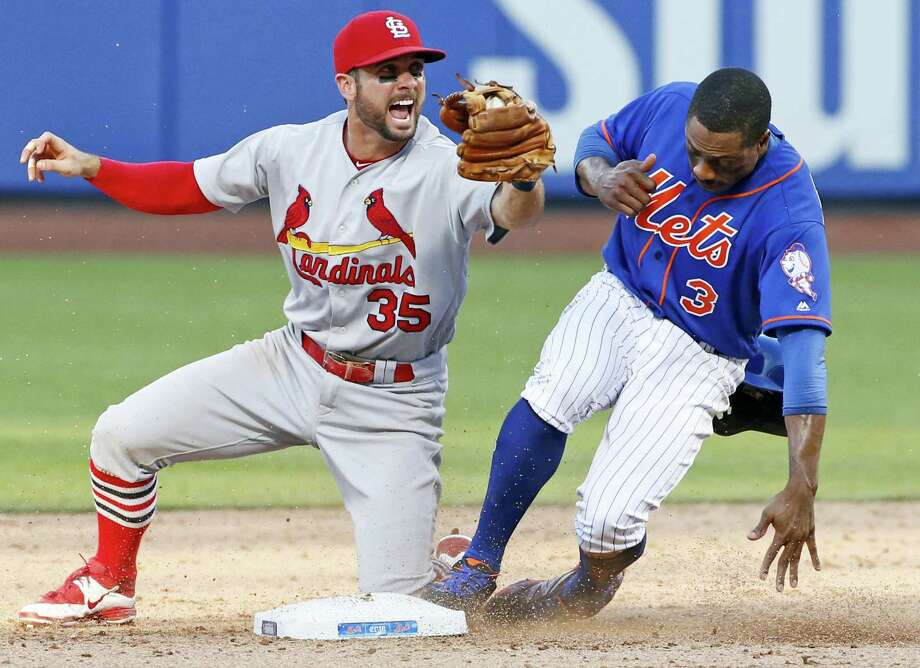St. Louis Cardinals second baseman Greg Garcia (35) reacts after tagging out New York Mets' Curtis Granderson (3) on a double play after Yoenis Cespedes flew out to center field during the ninth inning of the first game of a doubleheader Tuesday in New York. The Cardinals defeated the Mets 3-2. Photo: Kathy Willens — The Associated Press  / Copyright 2016 The Associated Press. All rights reserved. This material may not be published, broadcast, rewritten or redistribu