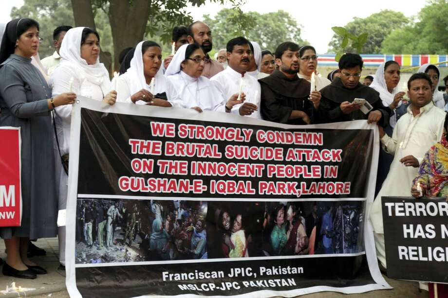 Pakistani nuns and members of civil society hold candles during a vigil for victims of the Sunday's deadly suicide bombing in a park on Monday, March 28, 2016 in Lahore, Pakistan. Pakistan's prime minister on Monday vowed to eliminate perpetrators of terror attacks such as the massive suicide bombing that targeted Christians gathered for Easter the previous day in the eastern city of Lahore, killing at least 70 people. Photo: AP Photo/K.M. Chaudary  / AP